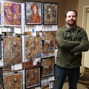 Ben Mirabelli with his artwork.